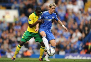 Norwich City's Leon Barnett and Chelsea's Fernando Torres battle for the ball during the Barclays Premier League match at Stamford Bridge, London.