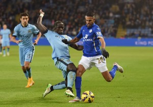 LEICESTER, ENGLAND - DECEMBER 13:  Riyad Mahrez of Leicester City is tackled by Bacary Sagna of Manchester City during the Barclays Premier League match between Leicester City and Manchester City at The King Power Stadium on December 13, 2014 in Leicester, England.  (Photo by Michael Regan/Getty Images)