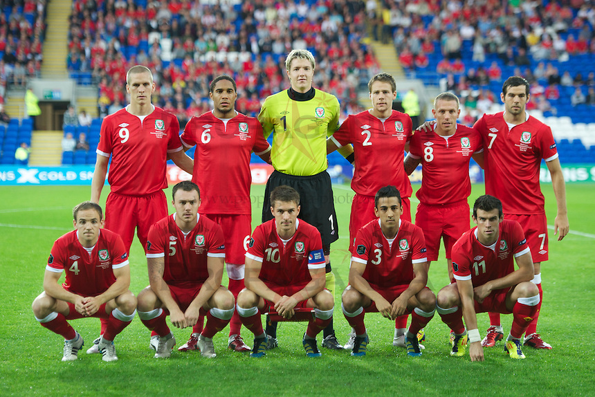 CARDIFF, WALES - Friday, September 2, 2011: Wales' players line up for a team group photograph before the UEFA Euro 2012 Qualifying Group G match against Montenegro at the Cardiff City Stadium. Back row L-R: Steve Morison, Ashley Williams, goalkeeper Wayne Hennessey, Chris Gunter, Craig Bellamy, Joe Ledley. Front row L-R: David Vaughan, Darcy Blake, captain Aaron Ramsey, Neil Taylor, Gareth Bale. (Pic by David Rawcliffe/Propaganda)